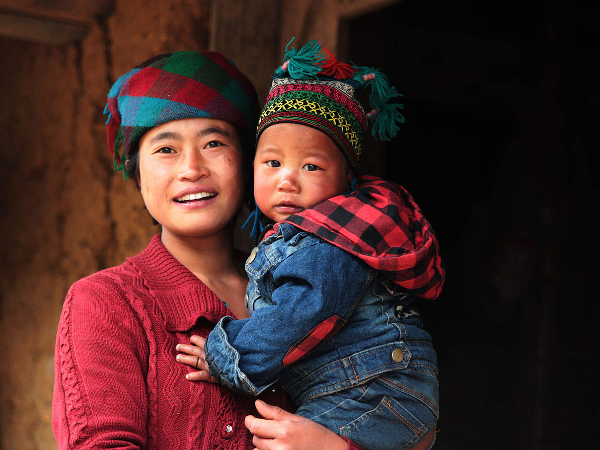 Frau mit Kind in Sechuan, China © Wang Yue